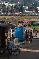 A man cooking at a kiosk on the street in Ooty, India.