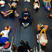 Boxer Reggie Davis takes a women's team boxing class through their routine at the Matt Dishman Community Center.  He pushes them to be their best and and they respond.