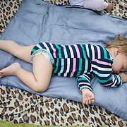 Daniel 1 year and 8 months old from Teheran, Iran sleeps at Moria camp, Lesvos, Greece.