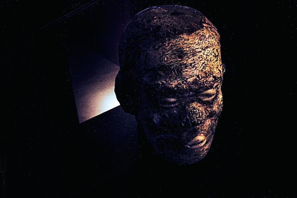 A stark, high contrast portrait of an effigy of Ellegua.