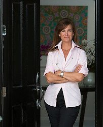 Beautiful woman standing in a doorway at home