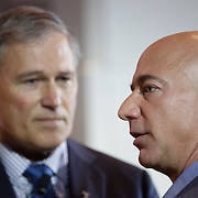 October 11, 2013 - Seattle, Washington, United States: Amazon.com Founder and CEO Jeff Bezos (R) is pictued with Washington Governor Jay Inslee (L) during a launch event for the Bezos Center for Innovation at the Museum of History and Industry. Bezos is also the owner of The Washington Post and founder of Blue Origin.