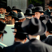 STRICKEN: Orthodox Jews, including Paul Reichmann (centre right, with hand on chin) assemble outside Agudath Israel Synagogue for the funeral of Moishe Nussbaum, who helped found the synagogue. Nussbaum was buried (Sept. 24/99) after being hit just before dawn by a car on Bathurst St. &amp;#xD;<br />