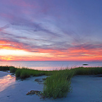 Escape - Cape Cod panorama photography pictures are available as museum quality photography prints, canvas prints, acrylic prints or metal prints. Prints may be framed and matted to the individual liking and home, office, lobby or room decorating needs:<br /> <br /> http://juergen-roth.pixels.com/featured/escape-juergen-roth.html<br /> <br /> Inspiring sunrise photo featuring a beautiful sunset at Cape Cod Skaket Beach; Located on the mid Cape the beach is easily reachable from Brewster, Dennis, Eastham or Orleans and only short drives away from Chatham, Wellfleet or Hyannis. This Namskaket Cape Cod panorama photography image was captured minutes after sunset when the light was painting the sky in beautiful blue and orange hues. The sun was reflected across the Cape Cod Bay and in the beach sand. The beach grass provided an interesting foreground inviting the viewer into the frame and to explore the photograph.<br /> <br /> Good light and happy photo making!<br /> <br /> My best,<br /> <br /> Juergen<br /> Prints: http://www.rothgalleries.com<br /> Photo Blog: http://whereintheworldisjuergen.blogspot.com<br /> Instagram: https://www.instagram.com/rothgalleries<br /> Twitter: https://twitter.com/naturefineart<br /> Facebook: https://www.facebook.com/naturefineart