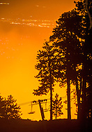 A ski lift is lit by the glow of the Pine Fire near Wrightwood, CA early Saturday morning. The fire was burning near summer camps and ski resorts closed for the summer. <br /> <br /> The North fire burns near Hesperia in San Bernardino County early Saturday morning July 18, 2015. The fire burned approximately 3,500 acres and was 35% contained. Nearby in Wrightwood the Pine Fire burned over 125 acres and was 0% contained. Evacuations were in place for both fires.