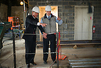 NEW YORK, NY &ndash; NOVEMBER 8, 2013:  CEO of Marriott Hotels, Arne Sorenson, left, at the at the Metropolitan Life Insurance Company Tower on Madison Square Park in Manhattan where a new brand of Marriott Hotels, Edition Hotel New York, is being installed and set to open in 2015. <br /> <br /> Photo &copy; Robert Caplin