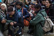 Idomeni, Greece - 14.03.2016      <br /> <br /> Refugees needed to cross a river close to the greek-macedonian border. Many refugees left the camp in Idomeni on the Greek- Macedonian border where they are partially stranded for weeks . With a March of Hope and they went to the point at which ended the Macedonian border fence and crossed the border there. Their path led through rough terrain, including crossing a cold river. In the Macedonian village Moin heavily armed police and military forces stopped the refugees. Present journalists were immediately taken into custody while the refugees were driven away in military transport.<br /> <br /> Die Fluechtlinge mussten einen kalten Fluss nahe der griechisch-mazedonischen durchqueren. Zahlreiche Fluechtlinge verlie&szlig;en das Camp in Idomeni an der griechisch-mazedonischen Grenze wo sie teilweise seit Wochen gestrandet sind. Mit einem March of Hope zogen sie zu dem Punkt an dem der mazedonische Grenzzaun endete und &uuml;berquerten dort die Grenze. Ihr Weg fuehrte durch unwegsames Gelaende inklusive eines kalten Flusses. In dem mazedonischen Dorf Moin stoppten schwer bewaffnete Polizisten und Militaers den Fliehenden. Anwesende Journalisten wurde umgehend in Gewahrsam genommen waehrend die Fluechtlinge wurde in Militaertransportern weggefahren. <br /> <br /> Foto: Bjoern Kietzmann