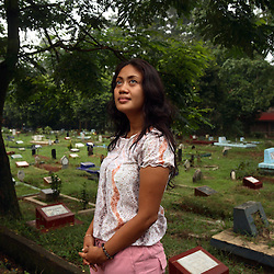Portrait of Lisa, 29, at the cemetery near her house in Jakarta, Indonesia, April 24, 2006. Her best friend Dede, 25, died in 2003 from an unsafe abortion that caused severe bleeding. It is said by doctors and activists that a woman dies every hour in Indonesia due to unsafe abortions.
