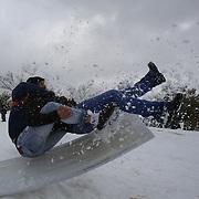 Israelis sled in snow, in Sacher park in Jerusalem. December 13, 2013.  Photo by Oren Nahshon