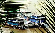 Cargo boats plying the mekong river tied up at Luang Prabang, Laos