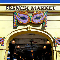 French Market Arch Entry in New Orleans, Louisiana<br /> Below rows of cast iron balconies are the famous (some would say infamous) streets of New Orleans&rsquo; French Quarter. This neighborhood is a swirling, vibrant kaleidoscope of architectural charm, neon lights, loud music, artisans, aromas of fresh fish and day-old beer. The area also welcomes throngs of people who thrill at watching people watch them as they strut, stroll or stumble along. Take time to visit the French Market, the country&rsquo;s oldest since 1791. Also sample some quick-serve Cajun specialties.