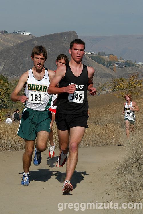The lead pack (L to R: Borah senior Sean Huey, Boise senior Nick Bolinder, Highland senior Taylor Farnsworth, and Borah senior Sawyer Bosch) during the Idaho High School Cross Country Boy's 5A State Championship at Hells Gate State Park in Lewiston, Idaho on October 29, 2006.<br />