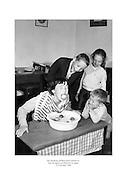 The Stephens children from Glasnevin bobbing for apples on Hallowe'en night.<br /> <br /> 31st October 1960<br /> 31/10/1960