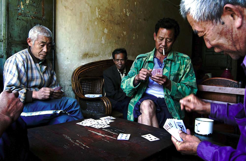 Men enjoy a game of cards in a tea house in Jianshui, Yunnan, China.