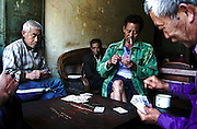 Men enjoy a game of cards in a tea house in Jianshui, Yunnan, China.