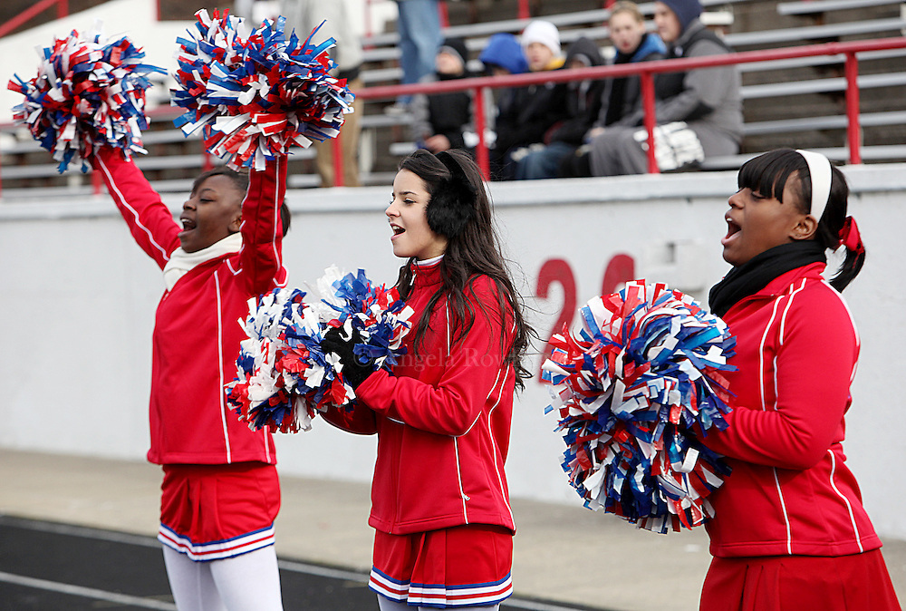 (112510  Boston, MA) South Boston High cheerleaders Michelle Jenkins, 16, left, Barjona Lamani, 16, and Jaquana Williams, 17, root for their football team during the annual game against East Boston High, Thursday,  November 25, 2010.  Staff photo by Angela Rowlings.