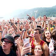 Concert goers in the rain at the Pemberton Music Festival.  Pemberton BC, Canada