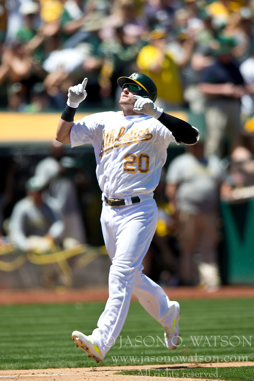 OAKLAND, CA - MAY 26:  Josh Donaldson #20 of the Oakland Athletics celebrates after hitting a home run off of Drew Smyly #33 of the Detroit Tigers (not pictured) during the third inning at O.co Coliseum on May 26, 2014 in Oakland, California. (Photo by Jason O. Watson/Getty Images) *** Local Caption *** Josh Donaldson