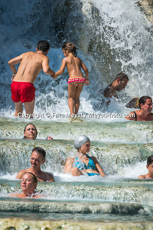Saturnia, Maremma, Tuscany, Italy, July 2016. The Cascate del Mulino in Saturnia are famous for its thermal healing sulphurous water.  the outdoor waterfalls are freely available to the public. The shoreline of Tuscany is at its best in the Maremma region; the name derives from Marittima, referring to the rugged coastal strip and inland hills of the Grosseto, Tuscany's southernmost province.  Photo by Frits Meyst / MeystPhoto.com