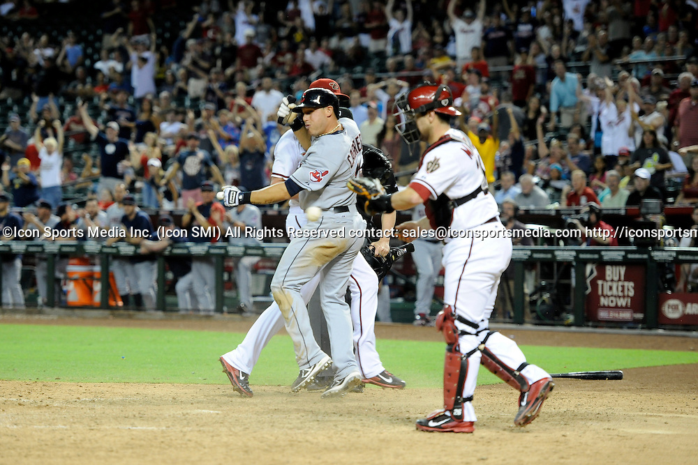 Jun 24, 2014; Cleveland Indians shortstop Asdrubal Cabrera (13) reacts after scoring the game tying run in the ninth inning against the Arizona Diamondbacks at Chase Field.