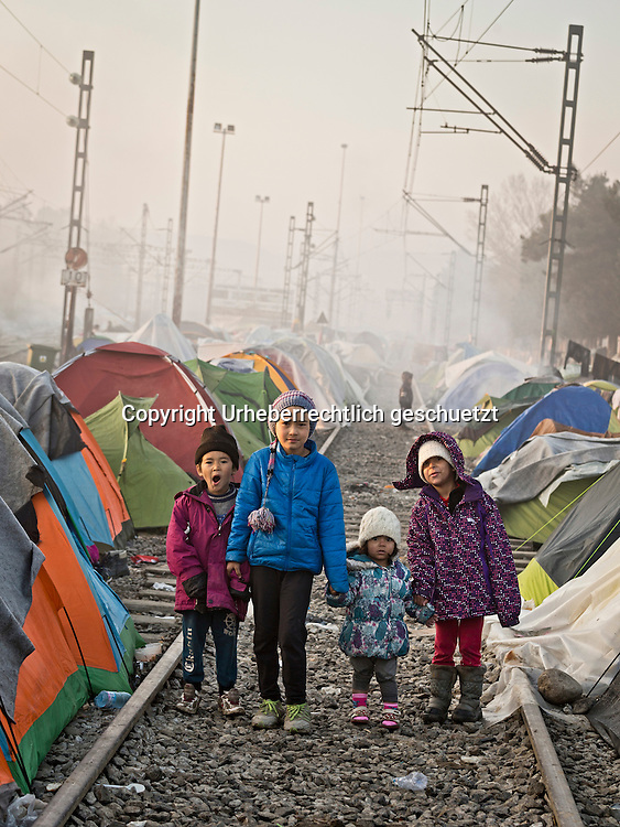 Greece, Idomeni, Refugees on their way to Europe,   <br /> <br /> Afghan kids on the railtrack near their tents going for a morning walk to the toilets.<br /> <br /> Refugees from Syria, Irak, Afghanistan and others from the near east are stucked at the border between FYROM (Macedonia) Idomeni, is the eye of a needle for getting to nothern Europe. <br /> The FYRO macedonian authorities, closed the border from Greece completely. The situation close to the border gets more and more difficult. There is not enough food and supplies to help about 12.000 refugees<br /> <br /> <br /> <br /> <br /> <br /> keine Veroeffentlichung unter 50 Euro*** Bitte auf moegliche weitere Vermerke achten***Maximale Online-Nutzungsdauer: 12 Monate !! <br /> <br /> for international use:<br /> Murat Tueremis<br /> C O M M E R Z  B A N K   A G , C o l o g n e ,  G e r m a n y<br /> IBAN: DE 04 370 800 40 033 99 679 00<br /> SWIFT-BIC: COBADEFFXXX