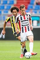 TILBURG - Willem II - Vitesse , Voetbal , Seizoen 2015/2016 , Eredivisie , Koning Willem II Stadion , 09-08-2015 , Willem II speler Stijn Wuytens (r) in duel we Vitesse speler Izzy Brown (l)