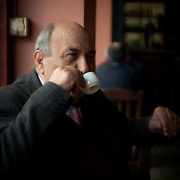 An Athenian local Dimitri sits in his Kafenion (cafe) drinking Greek coffee. He tells me he has been coming here for the past 33 years. Image © Angelos Giotopoulos/Falcon Photo Agency