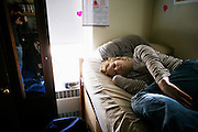 Melissa laying in her dorm room inside True House on February 28, 2006 in Athens, Ohio.