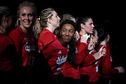 OMAHA, NE - DECEMBER 19: Outside hitter Tiani Reeves #22 of the Nebraska smiles at teammates before their NCAA finals match against the Texas at the CenturyLink Center on December 19, 2015 in Omaha, Nebraska.  (Photo by Eric Francis)
