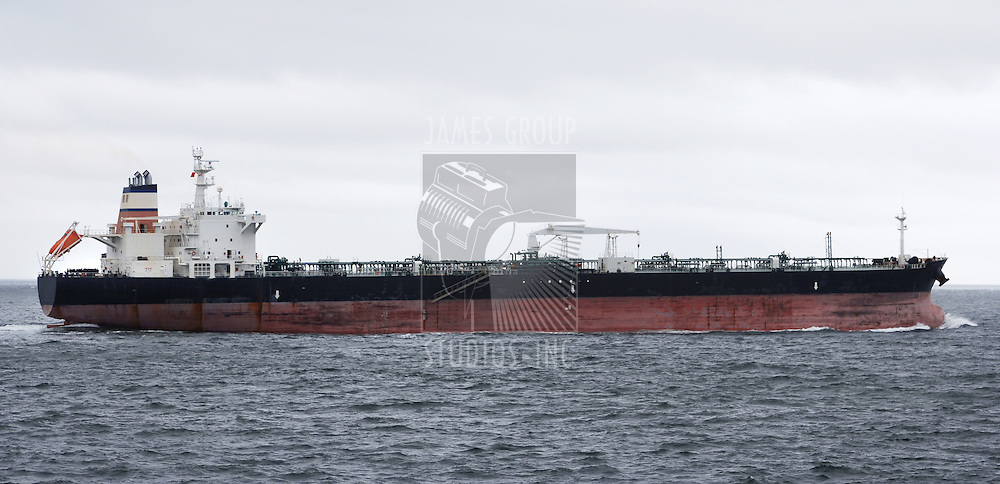 profile of an oil tanker heading out to sea