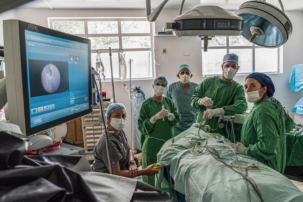 Dr. Roberto Alvarez operates on patients Maria Esmerelda Reyes, 4 mos at Occidente Hospital in Santa Rosa de Copan, Copan, Honduras on Feb. 10, 2017. Photo Ken Cedeno