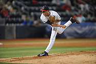 Ole Miss' Chris Ellis (10) pitches vs. Auburn at Oxford-University Stadium in Oxford, Miss. on Friday, April 4, 2014. Mississippi won 8-5.