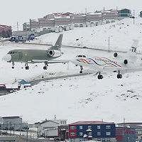Cold soak trial in Arctic Canada. Along side a Falcon 2000 on a ferry flight to the USA,  a Falcon 7X lands in Iqualuit, Nunavut, before moving north to Resolute Bay. April 2006.