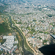 Rivers converge in densely populated Kathmandu Valley, as seen from a jet over Nepal, Asia. Kathmandu, the largest city in Nepal (700,000 people), is sometimes called Kantipur, a name from the Malla Dynasty. The city stands at an elevation of 6235 feet / 2230 meters.