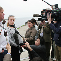 Tim Blackman ( father of murdered UK national Lucy), with daughter Sophie (in sunglasses), talk to the press after paying their respects to Lucy by visiting the cave, and drinking champagne in her memory, on the beach where her dismembered body was found, Aburatsubo beach, near Tokyo, Japan on Monday, April 23rd 2007.  The verdict will be announced in the trial of Joji Obara for Lucy Blackman's murder (and rapes of other women) on Tuesday April 24th 2007,