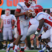 Delaware State Quarterback CORY MURPHY (6) attempts to hand off the ball in the pocket during a Week 2 NCAA football game against Delaware. <br /> <br /> Delaware defeated Defeated Delaware State 42-21 Saturday. Sept Sept. 07, 2013 in Newark Delaware.