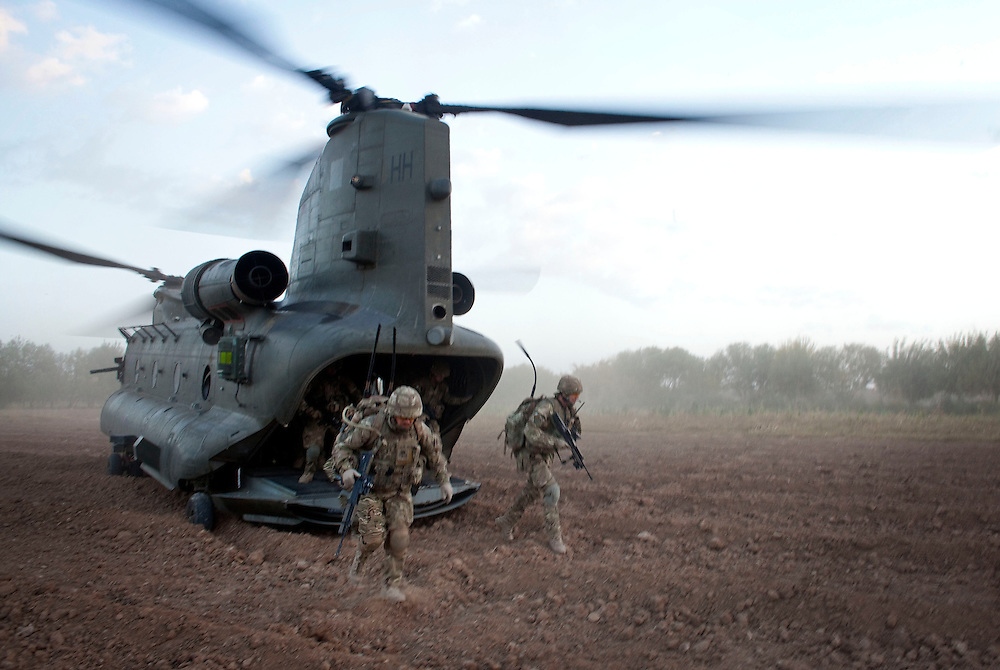 British soldiers from 1 PWRR (Princess of Wales's Roayl Regiment)  and from the Black Watch deploy from the back of a CH-47 Chinook near to Loya Manda,  as part of Operation Tora Pishaw 5 in Nad e Ali North, Helmand Province, Afghanistan on the 11th of November 2011.