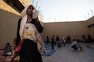 Libya, Garabulli: Ahua, from Niger is seen as she holds her daughter Agadas in the courtyard of Alguaiha detention center where migrants captured at the sea as they were attempting to reach Italy are kept, on May 12, 2015. Alessio Romenzi