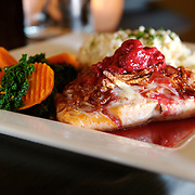 A potato crusted salmon with a raspberry champagne sauce is one of the entrees at Cafe Dodaci in Washington, Iowa. Photo by Scott Morgan