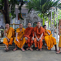 Monks waiting for the lunch bell, Battambang, Cambodia. Copyright 2014 Terence Carter / Grantourismo. All Rights Reserved.