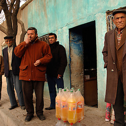 Ali Ipak  shops in one of the only local stores as neighbors watch December 13, 2005 in central Turkey, Konya in Kutoren district, about 400 kilometers from Ankara. The projects are meant to improve rural poor families livelihoods. (Ami Vitale)