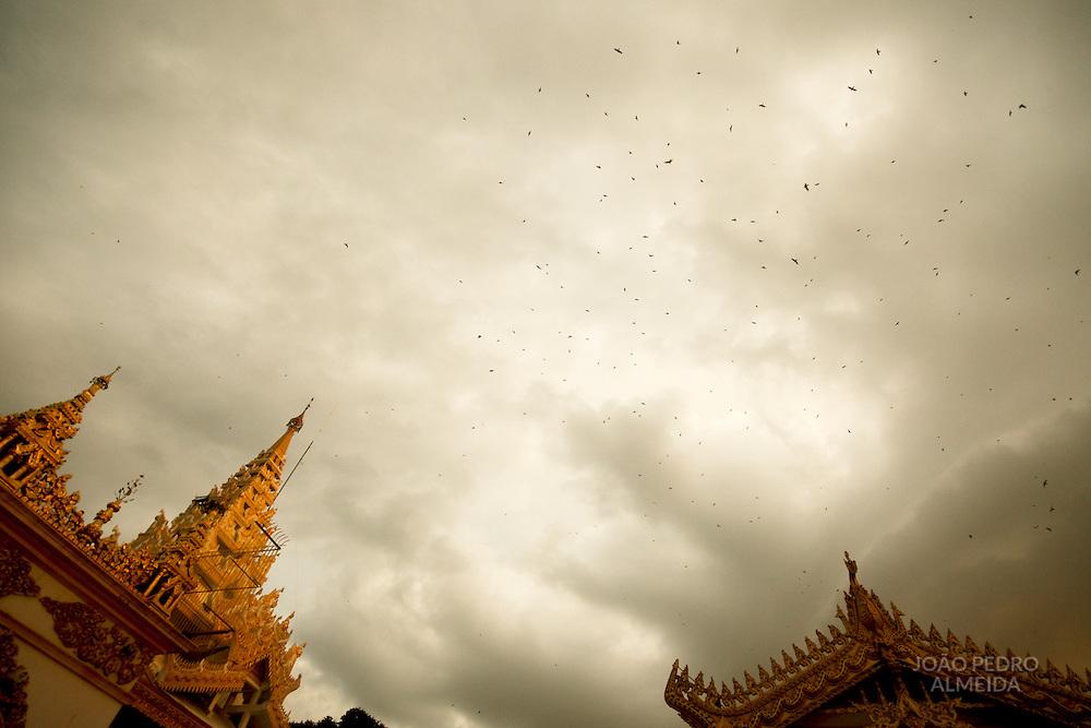 Birds fying over Mahamuni temple in Mandalay