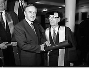 30/11/1992<br /> 11/30/1992<br /> 30 November 1992<br /> Conferring of Honorary Degrees (LL.D.) by the National Council for Educational Awards in Dublin Castle Conference Centre, Dublin. Picture shows Taoiseach Albert Reynolds, T.D. presenting Mr. J.C. Nagle, former Secretary of the Department of Agriculture,  with his degree. Mr. Nagle, from Cork, was Chairman of the Finance Committee of the Food and Agriculture Organisation of the United Nations. He was the first Chairman of the European Commission set up under the aegis of FAO for the control of Foot and Mouth disease. He was also involved in the 1948 and 1956 Trade Agreements with the UK. Mr. Nagle became the first Chairman of NCEA in 1971.