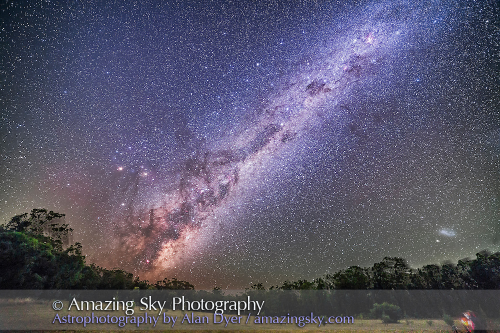 The Dark Emu of aboriginal sky lore rising in the east at the OzSky 2016 star party at Coonabarabran, NSW, Australia, on April 2, 2016. The sweep of the Milky Way from Carina at upper right to Sagittarius at lower left just rising takes in much of the splendours of the southern sky. The Dark Emu itself is made of dark lanes in the Milky Way, with the dark Coal Sack at upper centre forming his head and beak. The dark lane through Centaurus forms his neck. At left is Scorpius rising, with Mars and Saturn to the left of Antares. The Small Magellanic Cloud is at lower right setting. <br /> <br /> The Zodiacal Band and Gegenschein add the brighter sky at upper left. <br /> <br /> This is a stack of 5 x 3-minute exposures, all tracked on the iOptron Sky Tracker, and with the 14mm Rokinon lens at f/2.8 and filter modified Canon 5D MkII at ISO 2000. The ground comes from one 8-minute exposure at ISO 800 with the tracker motor off taken right after the tracked shots. This provides the sharp foreground, with a photographer with the OzSky star party at lower right. The composite does leave some ghosly trailed trees at left and along the horizon. But I think this looks rather neat.