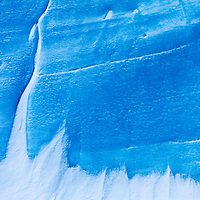 Antarctica, Wind-blown snow clings to vertical blue ice on glaciers on Anvers Island along Nuemayer Channel