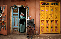A picture made available on 31 May 2013 of man of the Uighur  ethnic group having tea while his wife looks on in the old town of Kashgar, western edge of China's Xinjiang Uighur Autonomous Region, China 24 May 2013. Uighurs, a Muslim ethnic minority group in China, make up about 40 per cent of the 21.8 million people in Xinjiang, a vast, ethnically divided region that borders Pakistan, Afghanistan, Kazakhstan, Kyrgyzstan and Mongolia. Other ethnic minorities living in here include the Han Chinese, Kyrgyz, Mongolian and Tajiks people. In the restive region of Kashgar, western end of Xinjiang where the North and South Silk road meets, Uighurs comprise of more than 90 per cent of the 3.9 million population. Most practice a moderate form of Islam and religion is a major part of most ordinary Uighurs' lives. Tensions have been high between the Uighurs and the dominant Han Chinese as Uighurs complain of cultural and religious repression and claim that Han Chinese migrants enjoy the main benefits of development in the oil-rich but economically backward region.