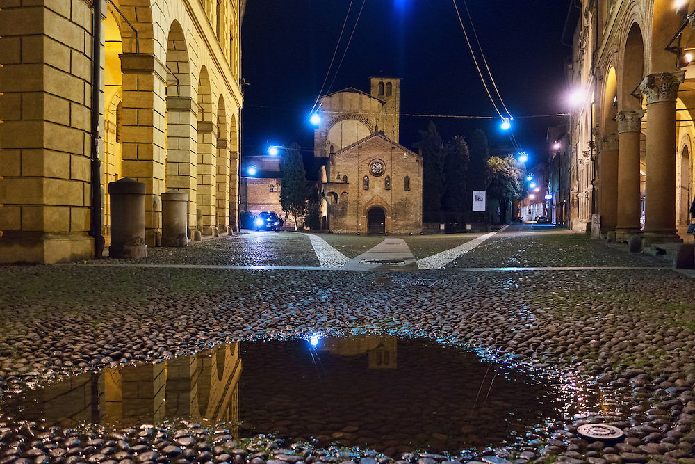 Piazza S. Stefano (Bologna) at night with a puddle in the foreground. Finalist in the Wiki Loves Monuments Italian contest 2016