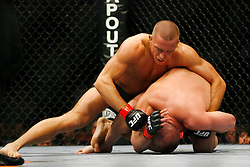 April 19, 2008; Montreal, Quebec, CAN;  UFC Welterweight Champion Matt Serra and Challenger George St. Pierre battle during their bout at the Bell Centre in Montreal, Canda at UFC 83.  St. Pierre regained the Welterweight title via 2nd round TKO.