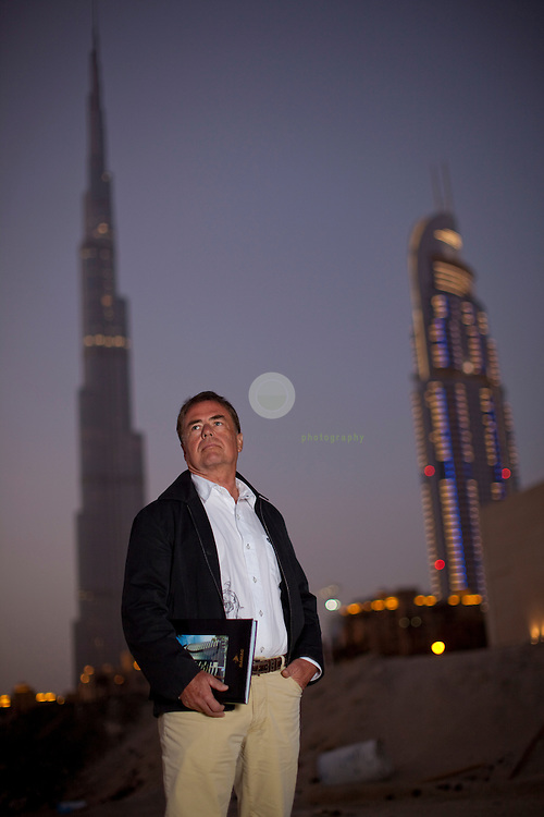 "Model release available | German investor Dr. Lothar Hardt: ASIA, UNITED ARAB EMIRATES, EMIRATE DUBAI, DUBAI, 09.02.2010. The German investor is suing Damac Properties for alleged breach of contract in what could be the largest lawsuit taken by an individual against a Dubai developer. Lothar Hardt has filed his case against one of the region's biggest developers and four of its executives at the Dubai International Financial Centre Courts. The DIFC courts follows English common law and, unlike the main Dubai courts system, allows foreign lawyers to represent clients and cases to be heard in English. Mr. Hardt is one of Damac's ""VIP investors"".  Here he stands at Business Bay in central Dubai, where he made an off-plan investment into the Water's Edge project - which until this day has not yet materialized."