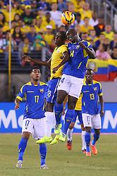 Sep 9, 2014; East Rutherford, NJ, USA; Brazil midfielder Ramires (8) and Ecuador midfielder Segundo Castillo (14) battle for the ball during the first half at MetLife Stadium.